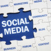 """A jigsaw puzzle with the text """"social media"""""""