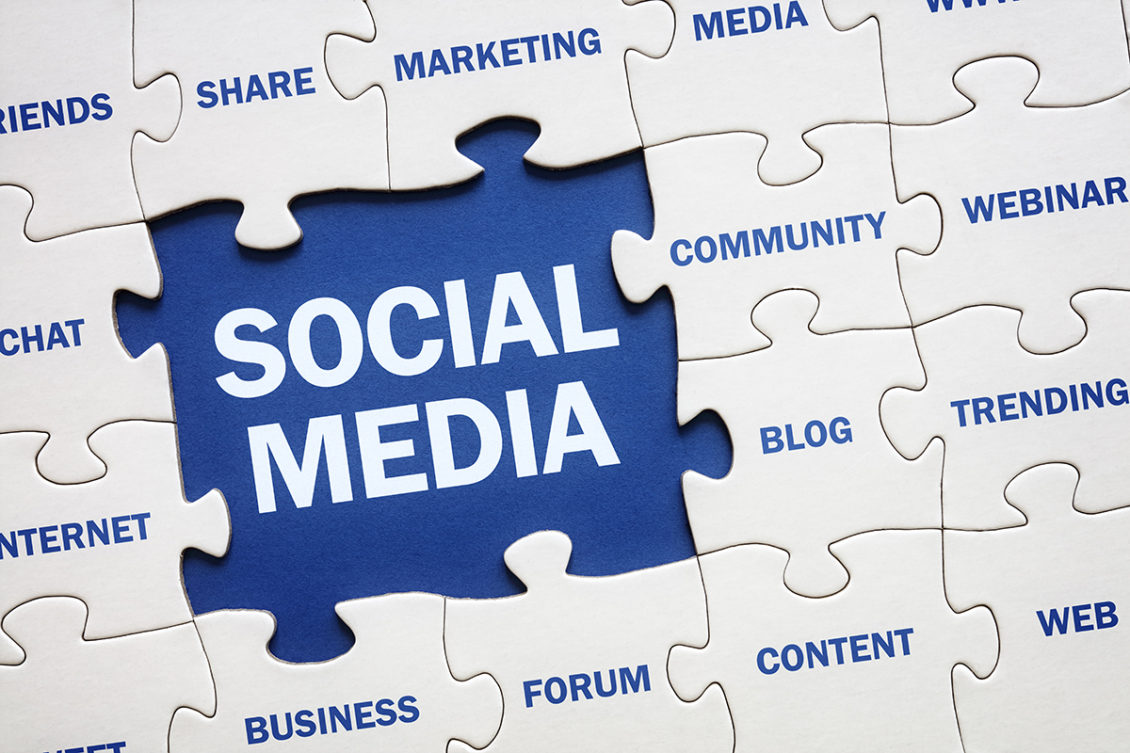 "A jigsaw puzzle with the text ""social media"""