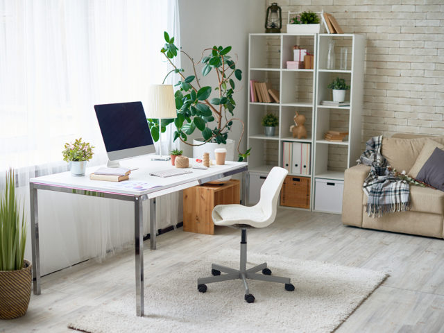 An image of modern home office with white chair and iMac